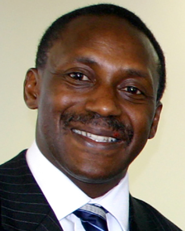 headshot of yumkella